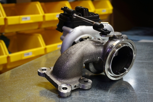 turbocharger sitting on a metal table