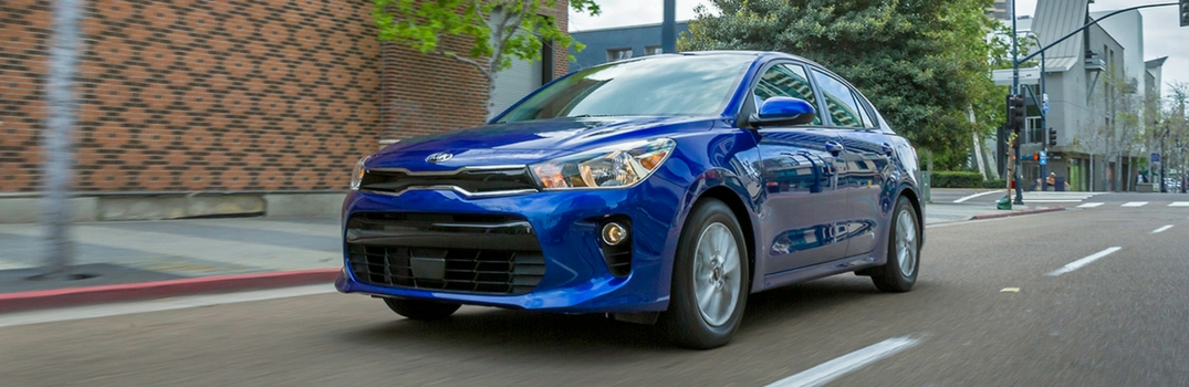 2018 Kia Rio driving on road.