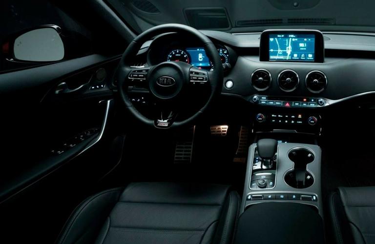 2018 Kia Stinger steering wheel and dash view.