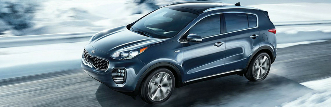 2019 Kia Sportage driving down the street
