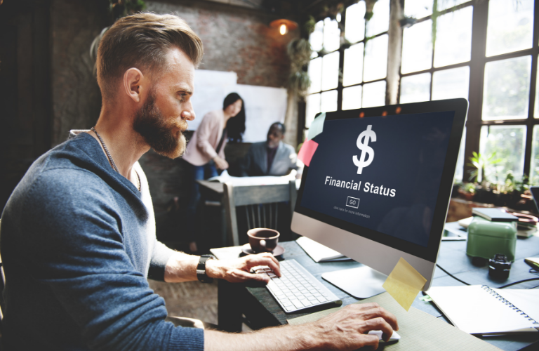 Man looking at the computer as he looks to finance