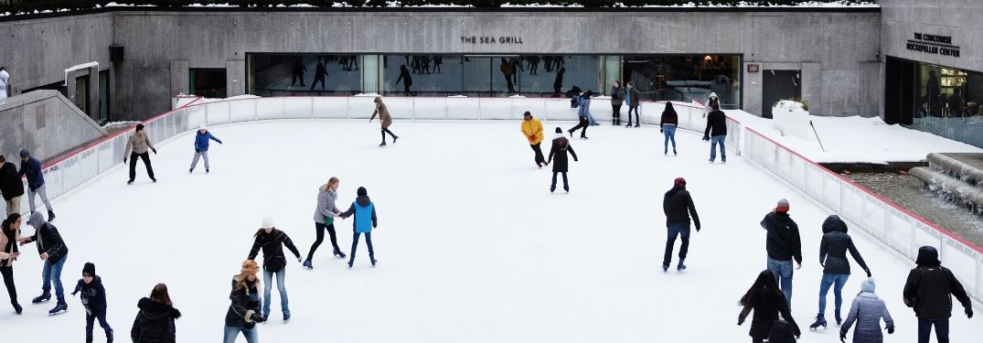 People ice skating at rink