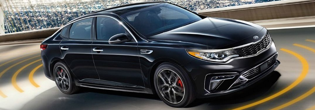 2020 Kia Optima driving on the road