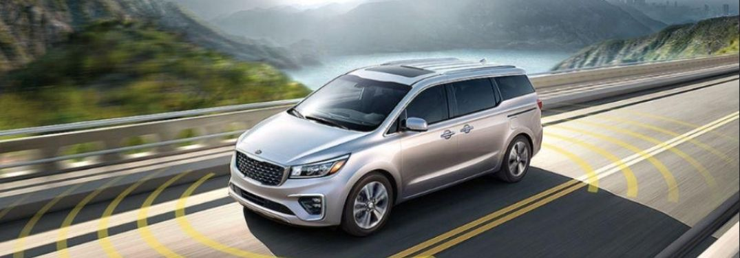 2021 Kia Sedona driving on the road side view