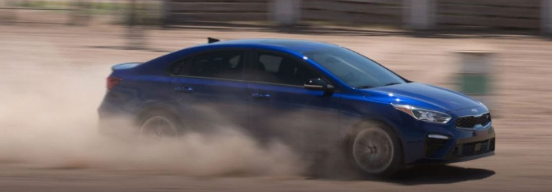 2021 Kia Forte driving on sand and dirt