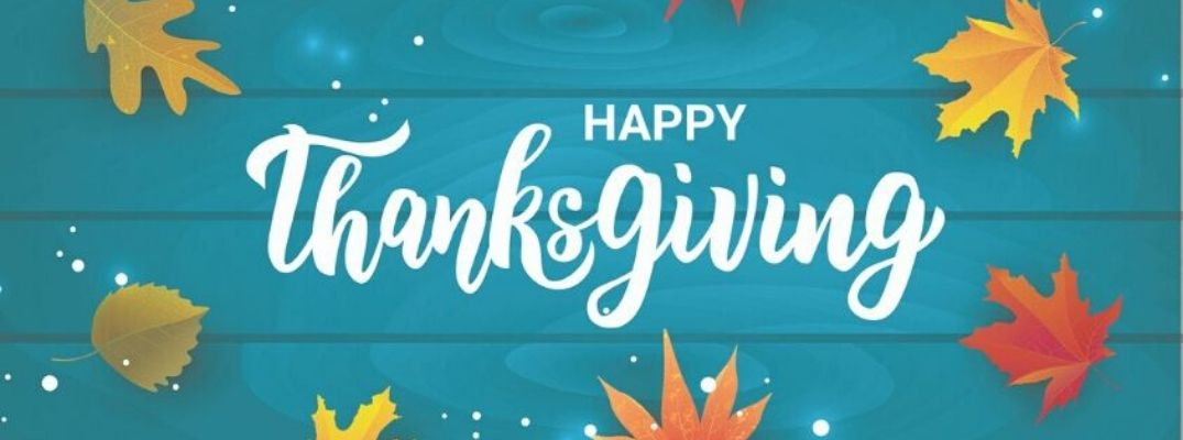 Happy Thanksgiving banner against a blue background with falling leaves