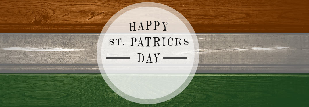 Happy St. Patrick's Day banner with Irish flag-colored wooden background
