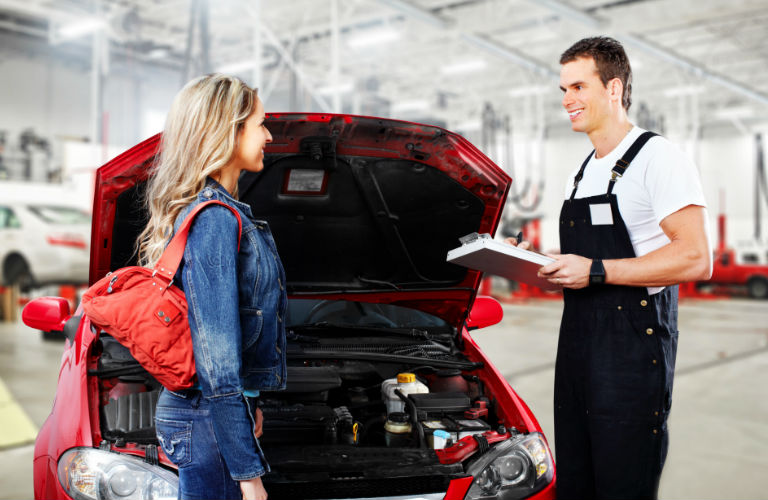 Mechanic talking with car owner