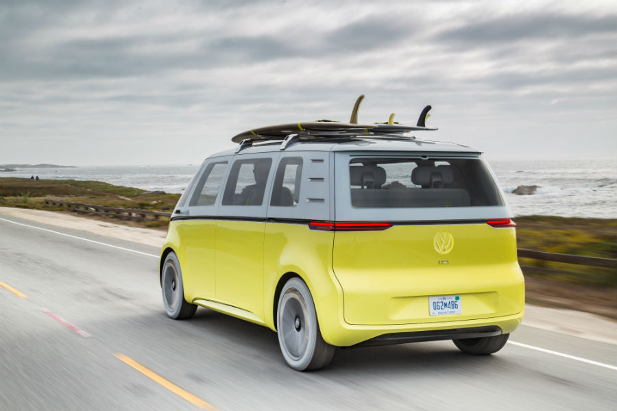 A yellow ID BUZZ electric microbus cruises down a highway, just like how Volkswagen is cruising toward an environmentally healthy future.