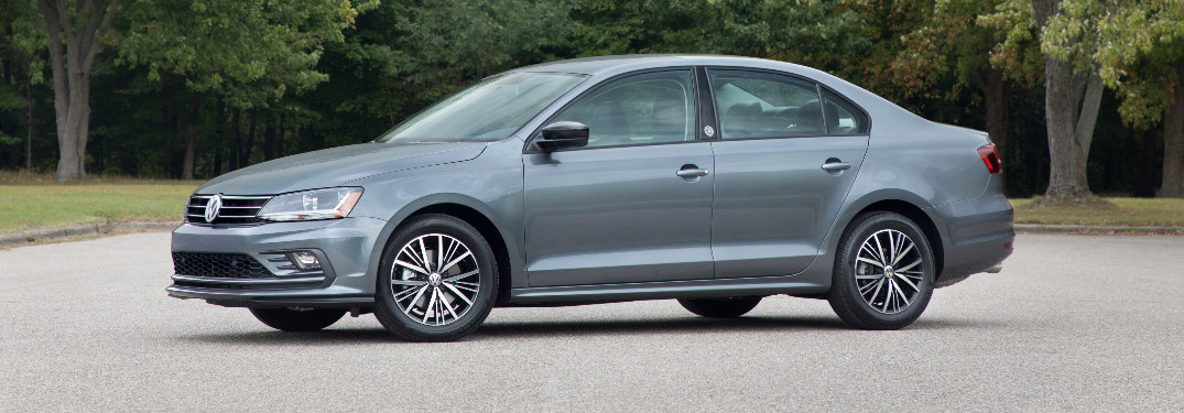 2018 Volkswagen Jetta in grey parked on a three-lined street