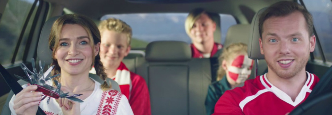 Family of soccer fans riding in the Volkswagen Tiguan