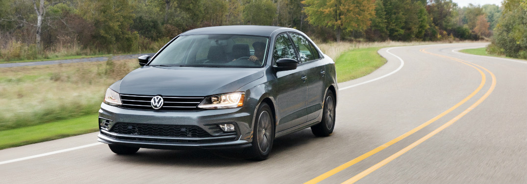 2018 Volkswagen Jetta in grey driving on a winding country road
