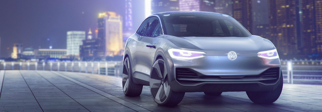 I.D. CROZZ Volkswagen electric concept vehicle parked in a futuristic city-scape.