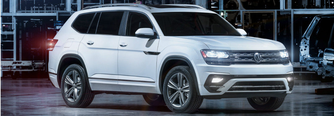 2018 Volkswagen Atlas R-Line sits in a futuristic garage. Exterior front angled view.