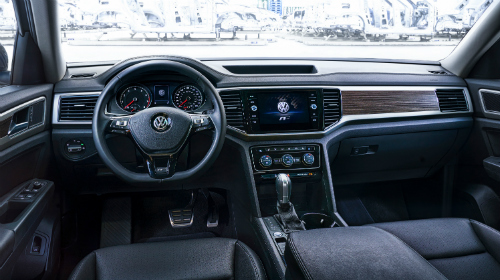 Front interior of 2018 Volkswagen Atlas R-Line, showcasing R-Line accents on the steering wheel and infotainment screen.
