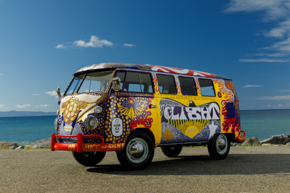 Psychedelic paintings adorn a re-creation of the Volkswagen Light Bus, a classic Volkswagen hippie bus that made an appearance at the Woodstock music festival in 1969.