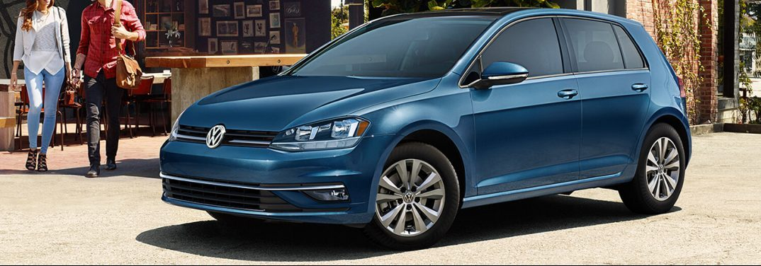 Blue 2019 Volkswagen Golf sits near a beach, providing an exterior front/side angled view.