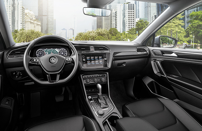 Front interior cabin of the 2019 Volkswagen Tiguan, featuring a possible CD player, heated steering wheel, and more.
