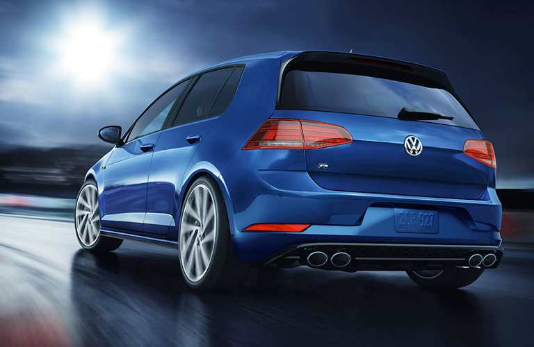 Blue 2019 Volkswagen Golf R drives placidly into that great night.