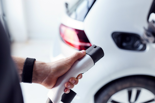 Person plugging in electric car