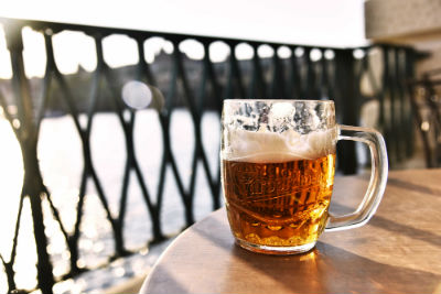 clear glass of beer on table outside