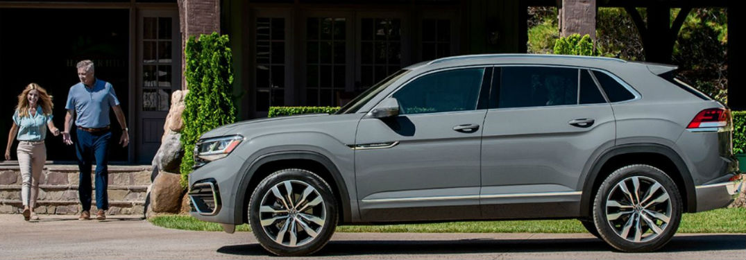 2020 VW Atlas Cross Sport silver exterior driver side parked couple walking out of house