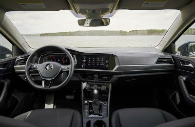 2020 VW Jetta interior view of steering wheel infotainment center and dashboard area