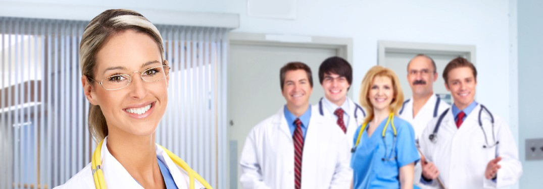 six doctors looking at camera and smiling