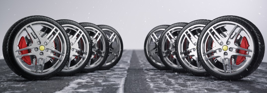 two rows of tires standing up staggered in toward each other