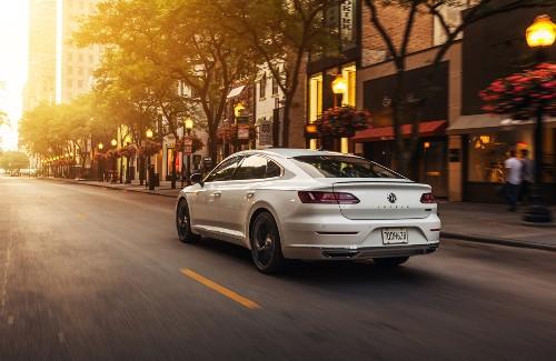 2020 VW Arteon white exterior rear driver side driving
