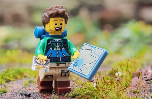Lego figuring with map compass and hiking gear