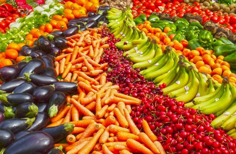 large organized pile of fruits and veggies