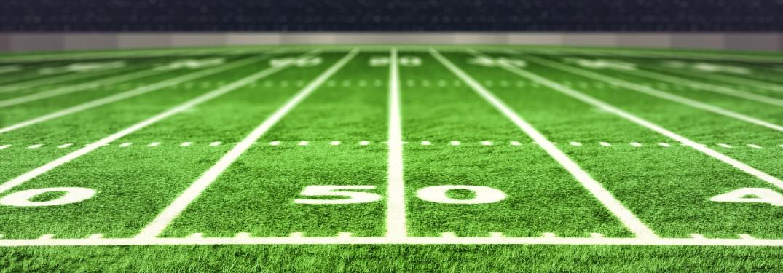 close up of football field at 50 yard mark