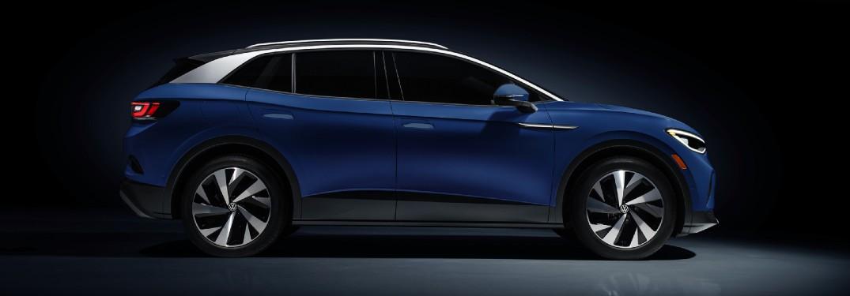 2021 VW ID4 blue exterior passenger side parked black background