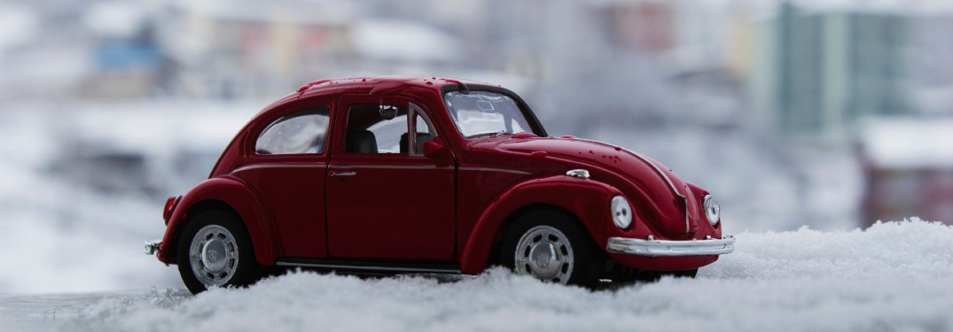 small red toy car in snow