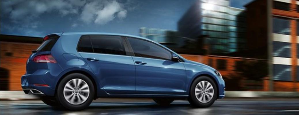 Blue 2020 Volkswagen Golf driving on road