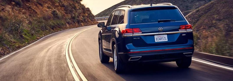 2021 Volkswagen Atlas driving down curved road