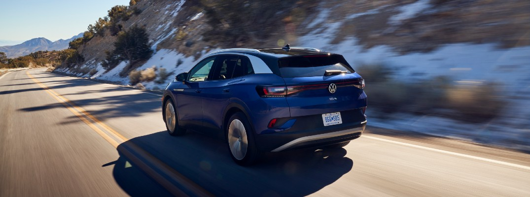 A rear left quarter photo of the 2021 Volkswagen ID.4 on the road.