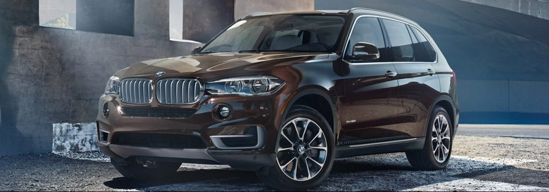 2017 BMW X5 in brown parked in a city lot