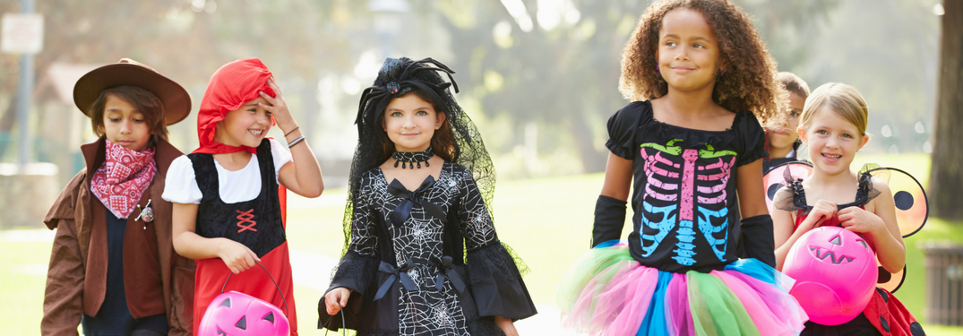 Kids in Halloween costumes go trick or treating