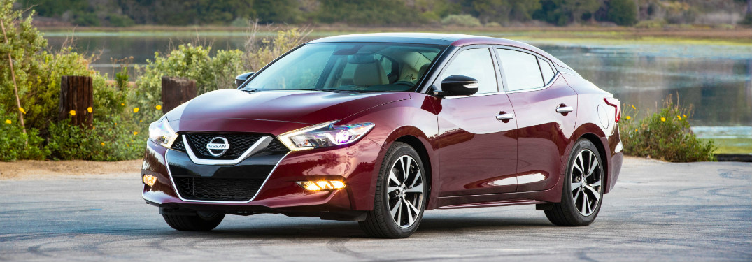 front and side view of red 2018 nissan maxima