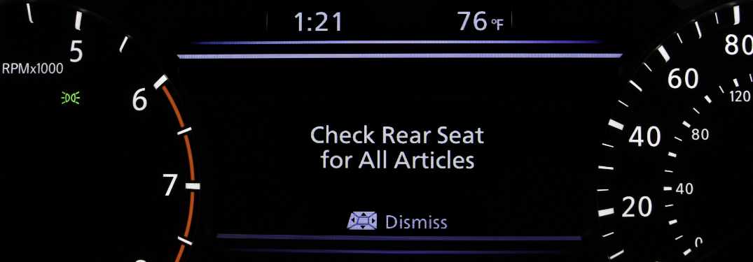rear door alert technology notification in instrument cluster of nissan vehicle