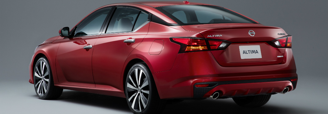 rear and side view of red 2019 nissan altima against gray background