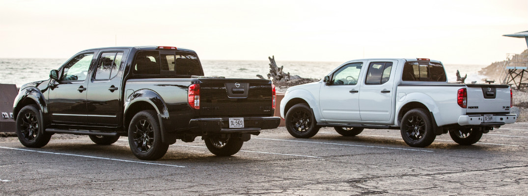 rear and side view of white and black 2019 nissan frontier