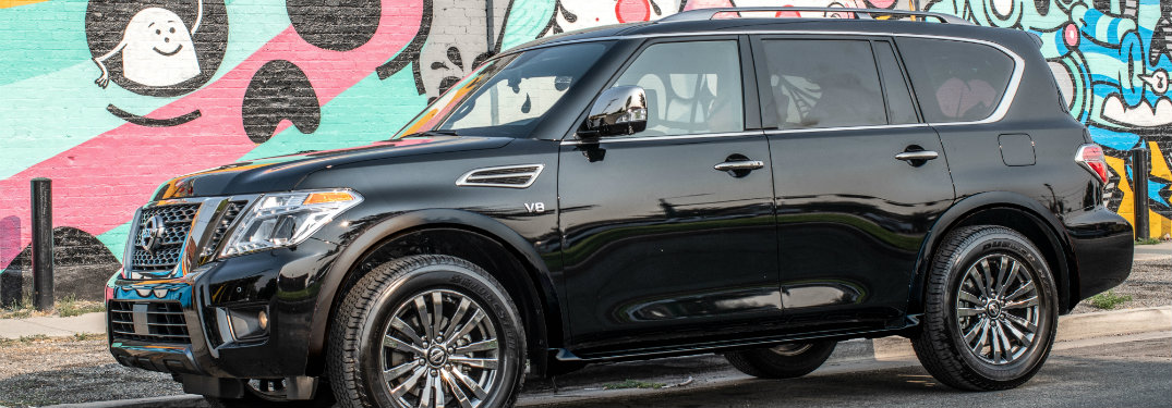 side view of black 2019 nissan armada