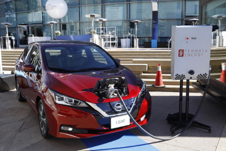 front view of red 2019 nissan leaf charging at station