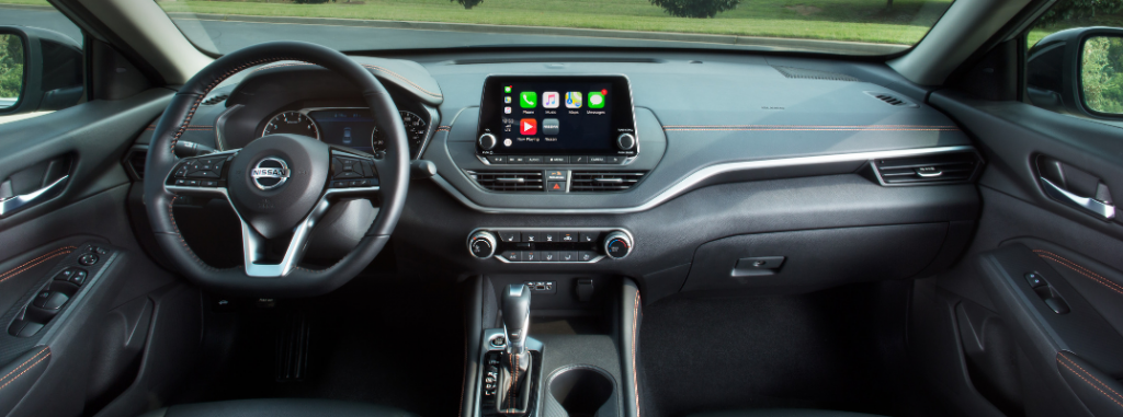 front interior of 2019 nissan altima including steering wheel and touchscreen