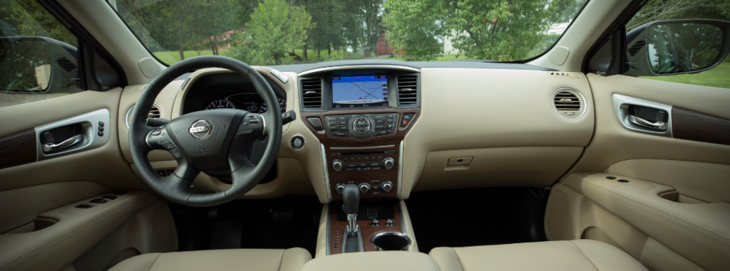 front interior of 2019 nissan pathfinder including steering wheel and infotainment system