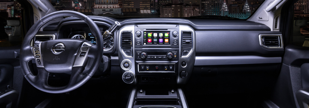 front interior of 2019 nissan titan including steering wheel and touchscreen with apple carplay