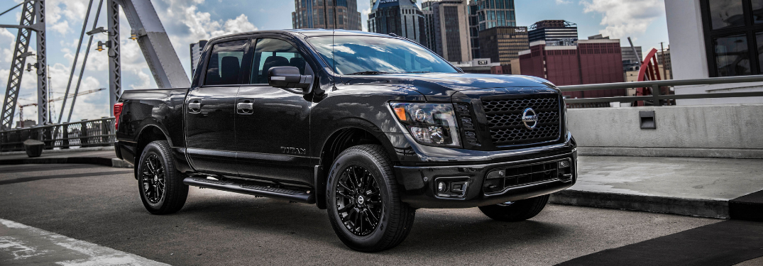 front and side view of 2019 nissan titan midnight edition